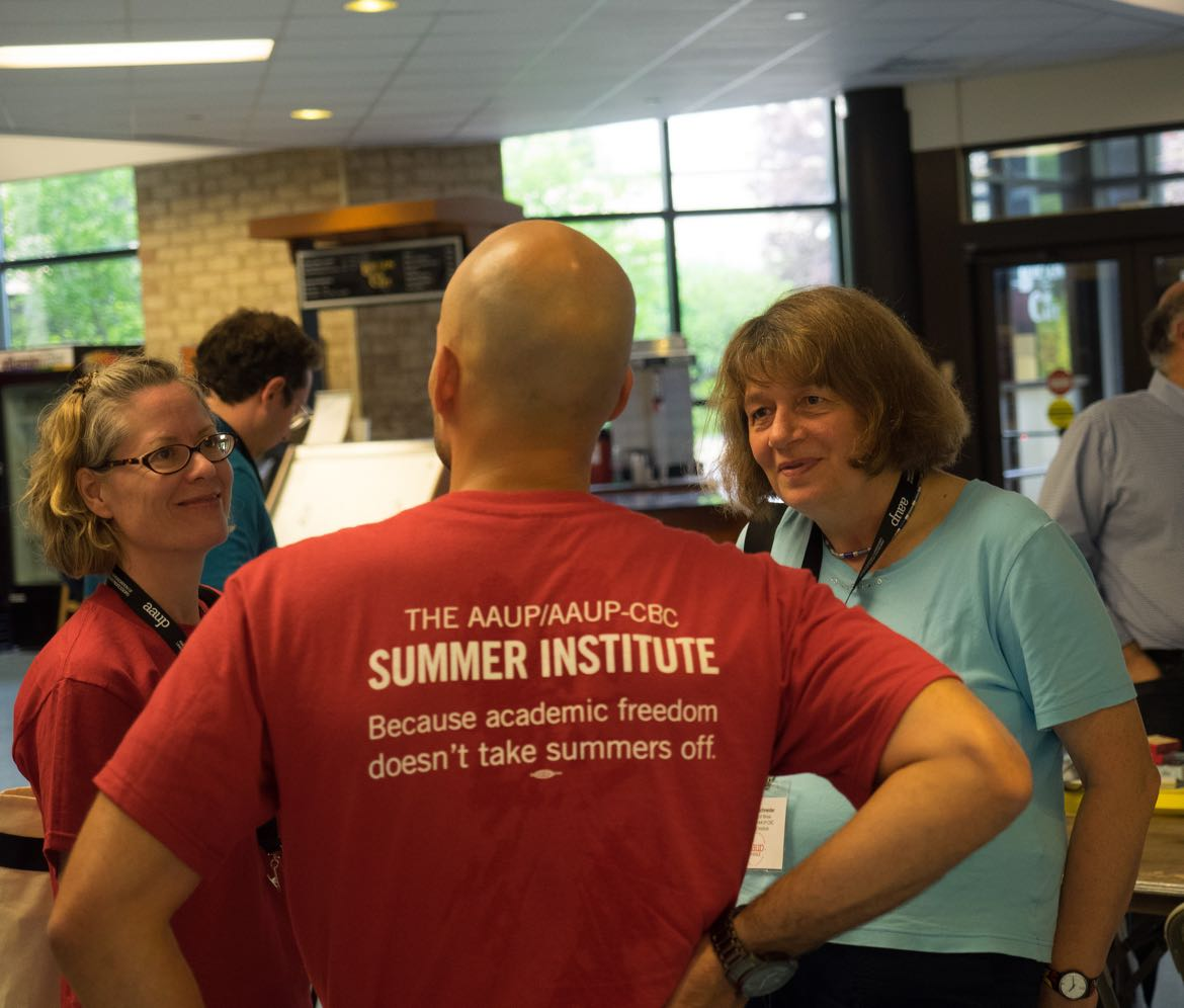 Man wearing t-shirt from AAUP summer institute.